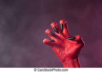 Red devil hand with black glossy nails