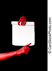 Red devil hands with black nails holding paper scroll
