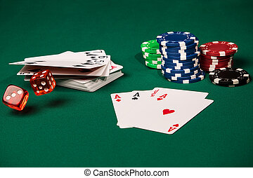 Red dice, casino chips, cards