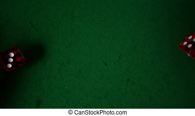 Red dice falling on casino table