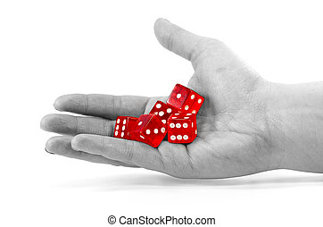 red dice in a desaturated hand
