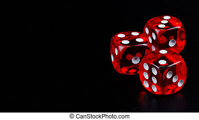 Red dice in dark black background