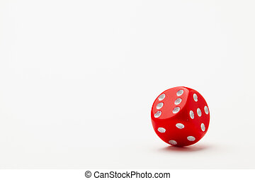 Red dice on the white table.