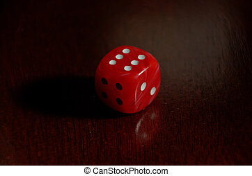 Red Die shows result of six