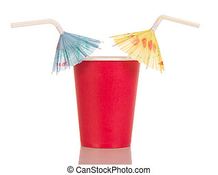 Red disposable cup with straw umbrellas isolated on white. -...