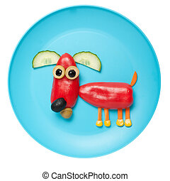 Red dog made of pepper on plate