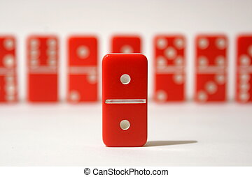 Red Dominoes - Red dominoes set against a white background