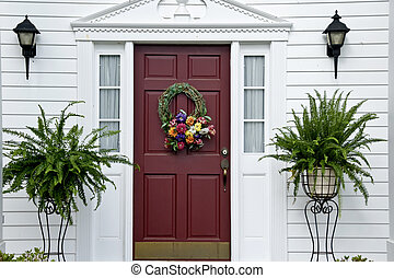Red Entry Door graced with green ferns.