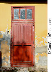 red door in a stable