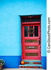 Red door - In Blue wall in the Historic District in Down ...