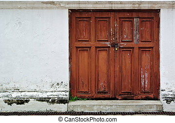 Red door in old white wall