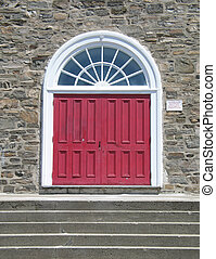red door on a stone wall