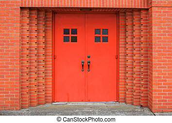 Red doors brick wall