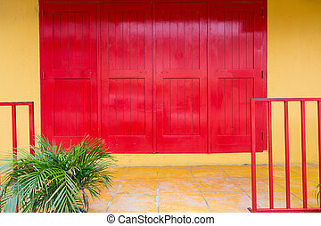 Red Doors on Yellow Wall