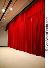 Red draped theater stage curtains with lights