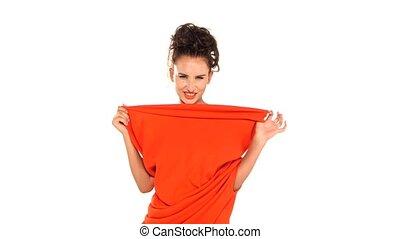 Red dress-changeling wears brunette attractive woman on white backgruond
