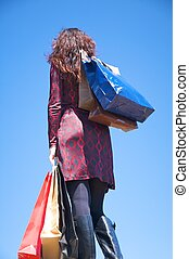 red dressed woman shopping
