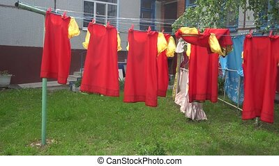 red dresses drying on the street