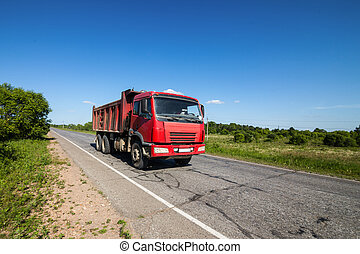 Red dump truck on a road