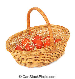 Red Easter eggs in a basket.