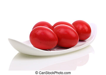 Red Easter eggs in a dish