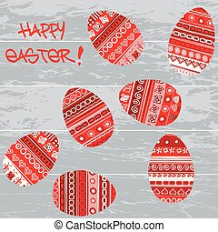 Red Easter eggs on wooden background