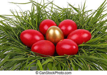 Red Easter eggs with gold egg