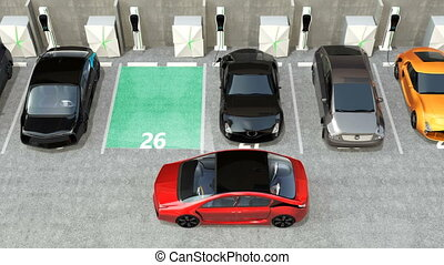 Red electric car in parking lot - Red electric car driving...