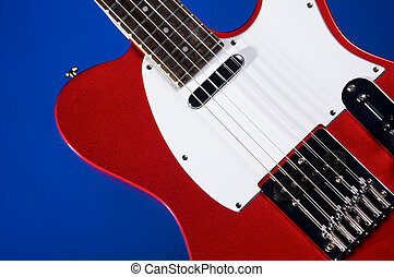 Red Electric Guitar On Blue