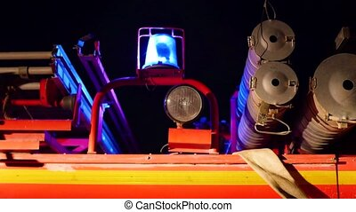 Red emergency flashing lights of a fire truck. at night time...