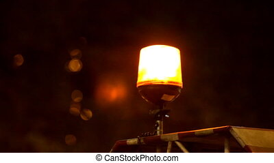 Red emergency light flashing at night