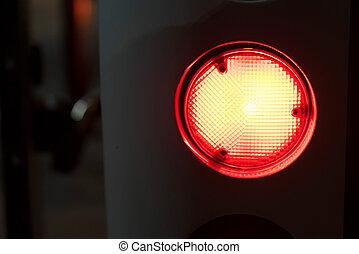 Red emergency light glows in dark close