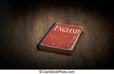 Red English textbook on a wooden table