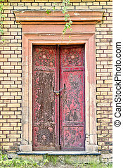red entrance to an old tomb