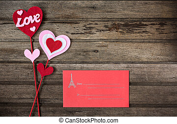 Red envelope and valentine decoration with word LOVE on old wooden background