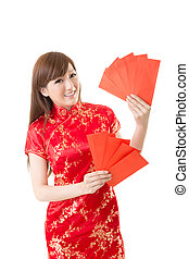 Attractive Chinese woman dress traditional cheongsam and hold red envelope, closeup portrait on white background.