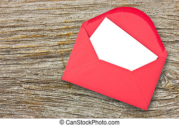 Red envelope on wooden background