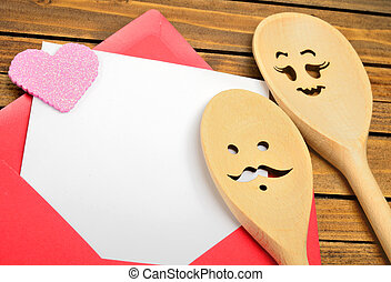 Red envelope with couple wooden spoon
