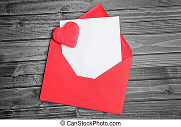 Red envelope with empty paper on table