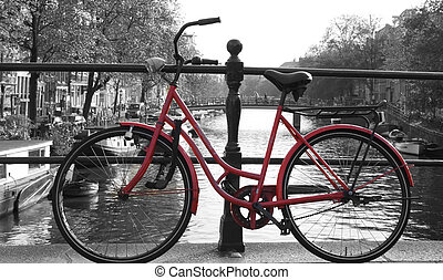 Red European Bike next to river. - Red european bike next to...