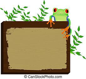 frog sitting on wood background
