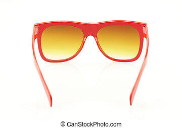Red eyeglasses on white background