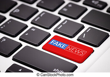 red fake news button on laptop keyboard. fake news on internet in modern digital age concept