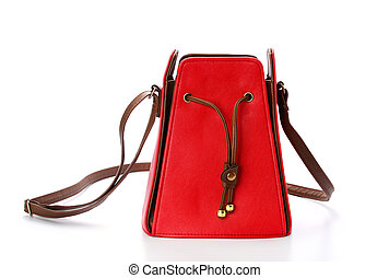 Red female leather bag isolated on white background