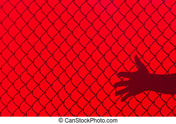 Red Fence and hand Shadow, concept of freedom