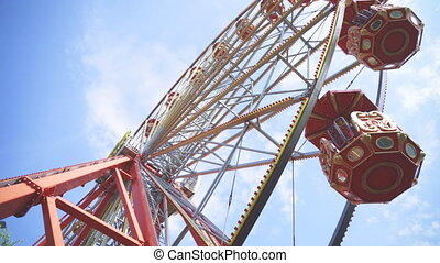 Red ferris wheel in the city park.