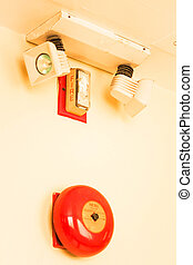 Red fire alarm bell on the wall