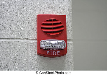 Red Fire Alarm with Strobe - A red fire alarm with built in...