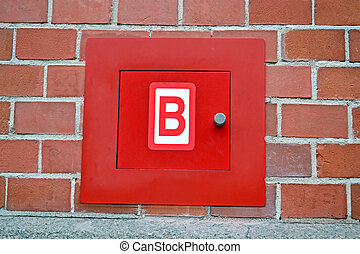 red fire box for hydrant, red brick wall, modern security