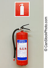 Red fire extinguisher - Fire extinguisher on the gray wall